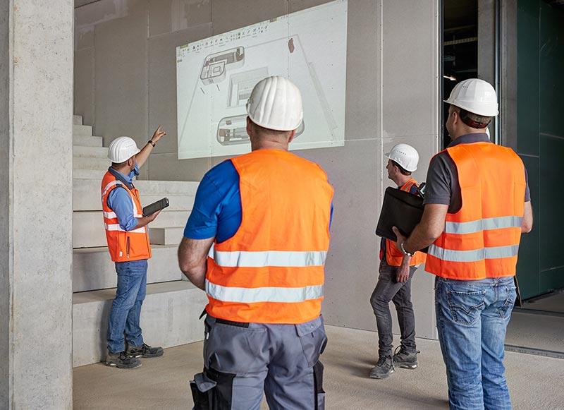 Baubesprechung am digitalen Modell: Hochbauprojekte werden standardmäßig mit BIM abgewickelt. Foto: Swen Carlin